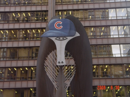 The Daley Plaza Picasso sculpture of a woman's face sports a Cubbie blue lid at a playoff pep-rally in October, 2008. Photo by Albert Covera.