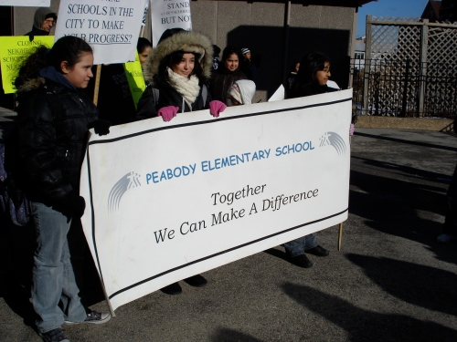 Students, parents and teachers gather outside of Elizabeth Peabody Elementary, 1444 West Augusta Blvd., on Feb. 19 for a neighborhood march to protest shutting down their school. The school was taken off the list of closings four days later. Photo by Christopher Brinckerhoff.